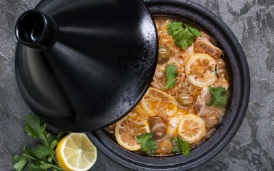 Chicken cooking in traditional tagine.  With lemons, green olives and cilantro.